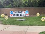 Heroes Work Here! by Monarch Landing