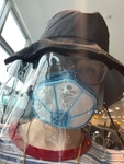 Face mask and hat with face shield worn for cross-country flight by Margaret Lachman